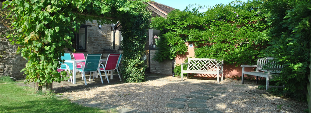Sunny south facing patio with plenty of garden furniture